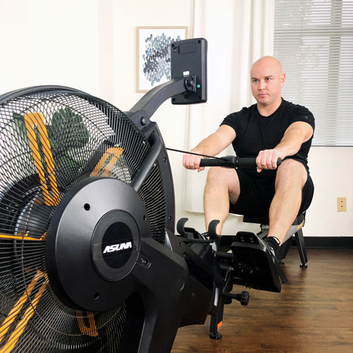 Sunny fitness trainer Matt is rowing