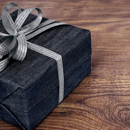 a gift box on wood table