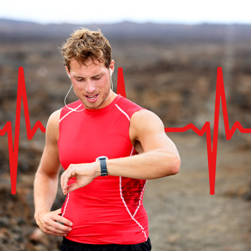 a man is monitoring his heart rate after exercising
