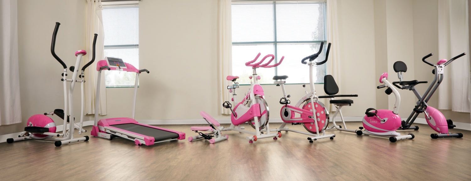 room filled with pink fitness equipment