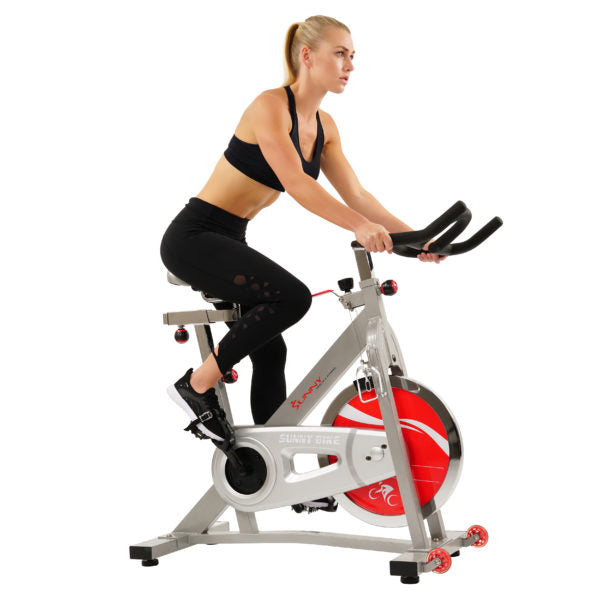 woman riding an indoor cycle bike