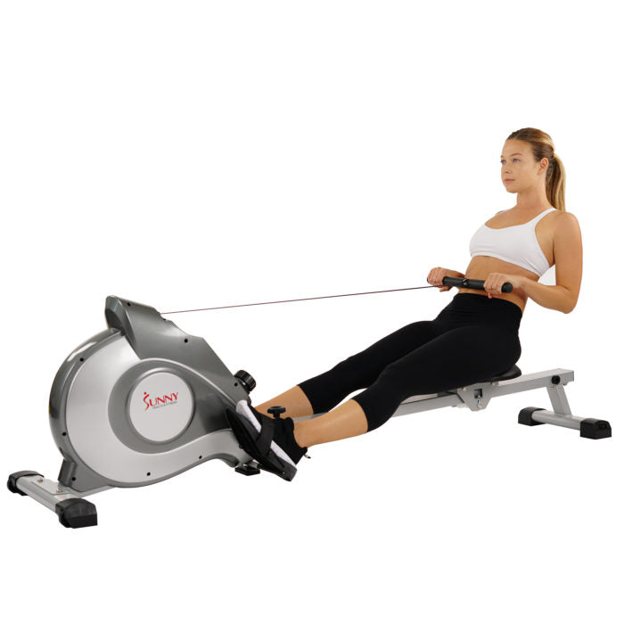 woman rowing on rower machine