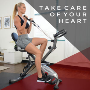 woman pulling resistance bands on upright exercise bike