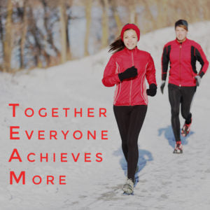 woman and man running in snow with text together everyone achieves more