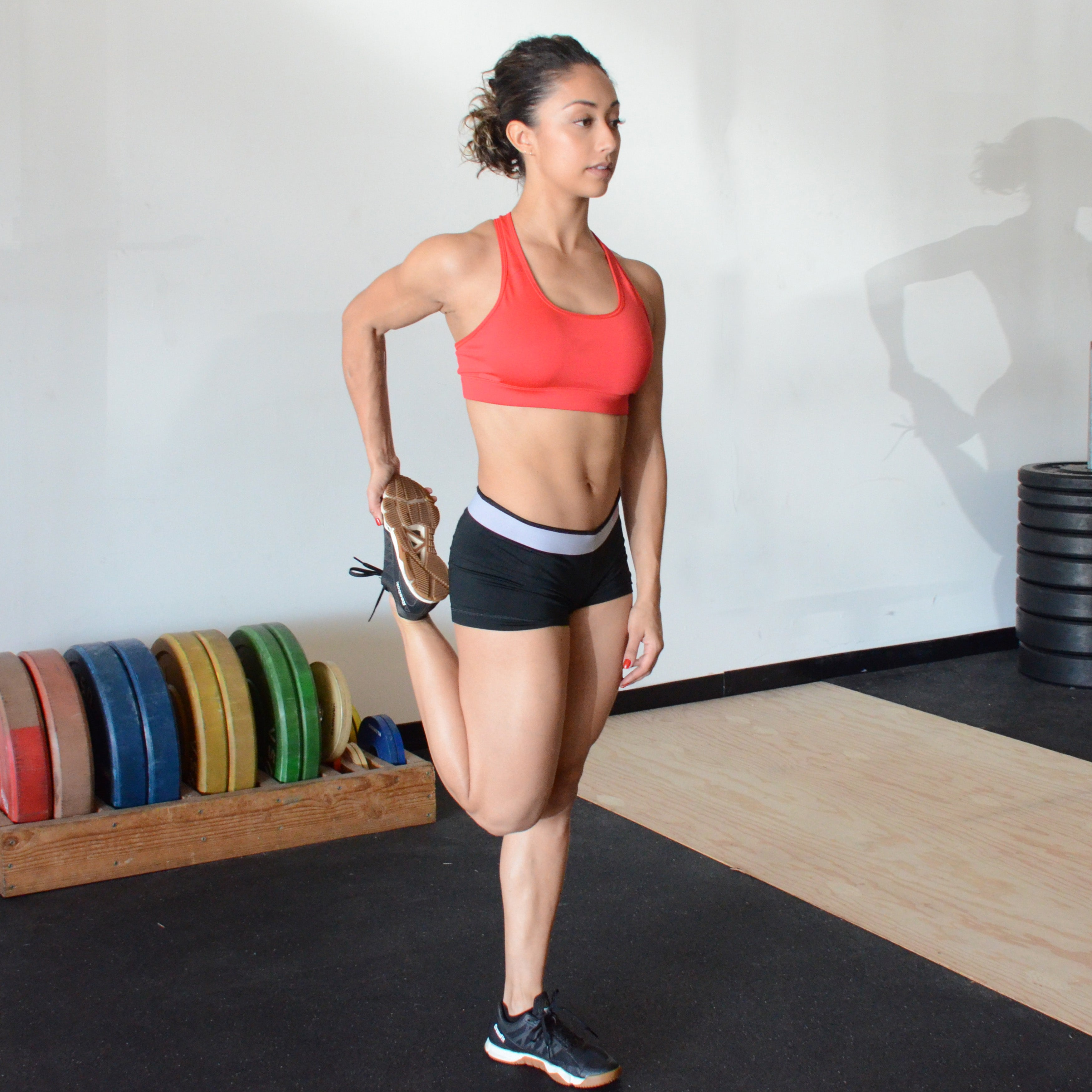 Fitness Trainer Quad Stretch
