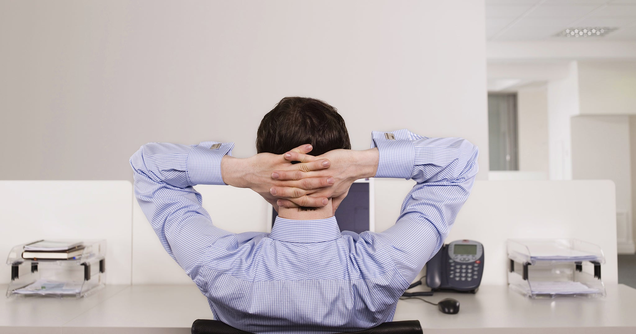 an office man putting his hands on head