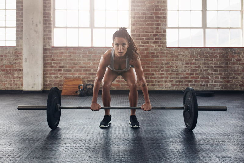 woman performing deadlift