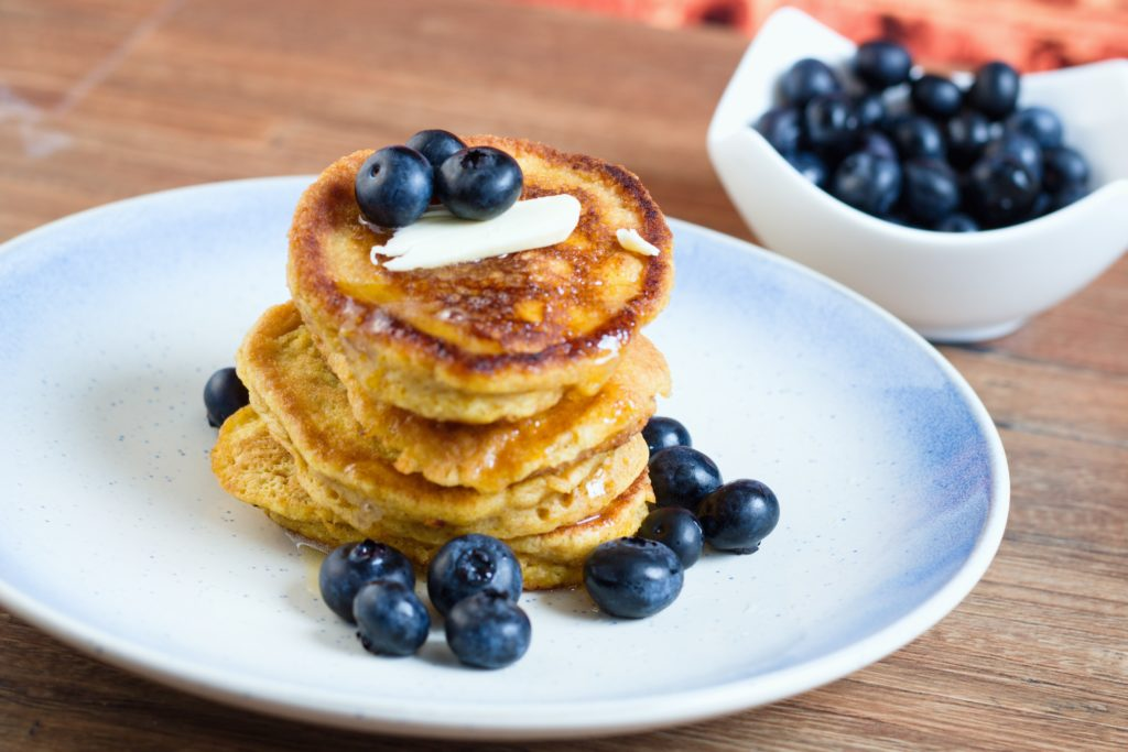 banana pancakes with blueberries on plate