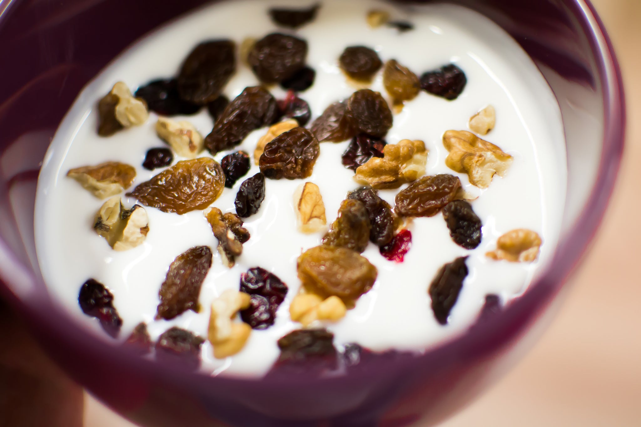 yogurt with raisins and nuts in a bowl