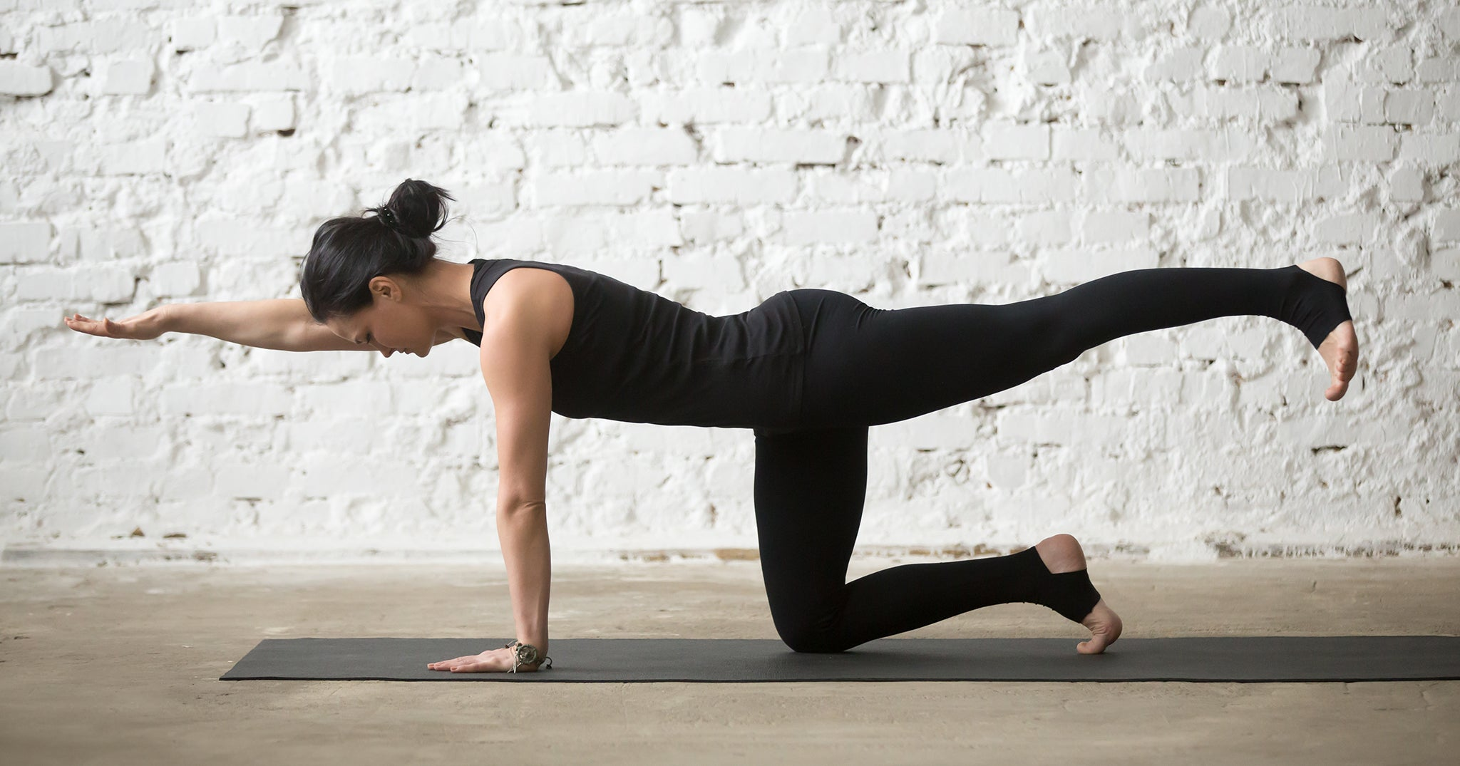 a woman is stretching