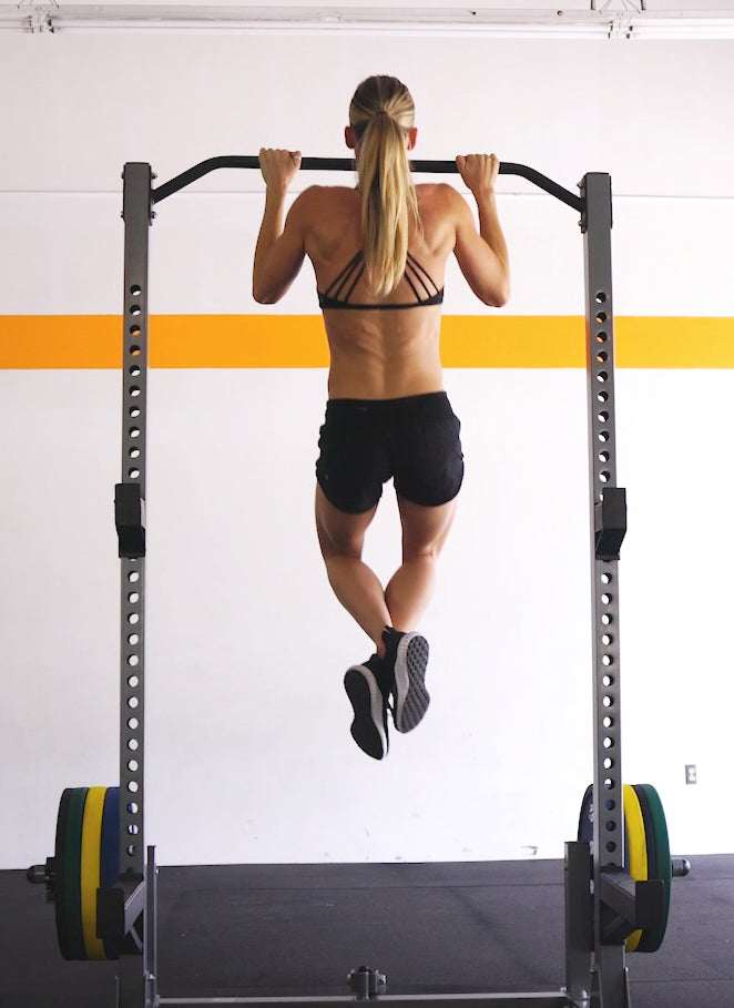 woman performing a pull up