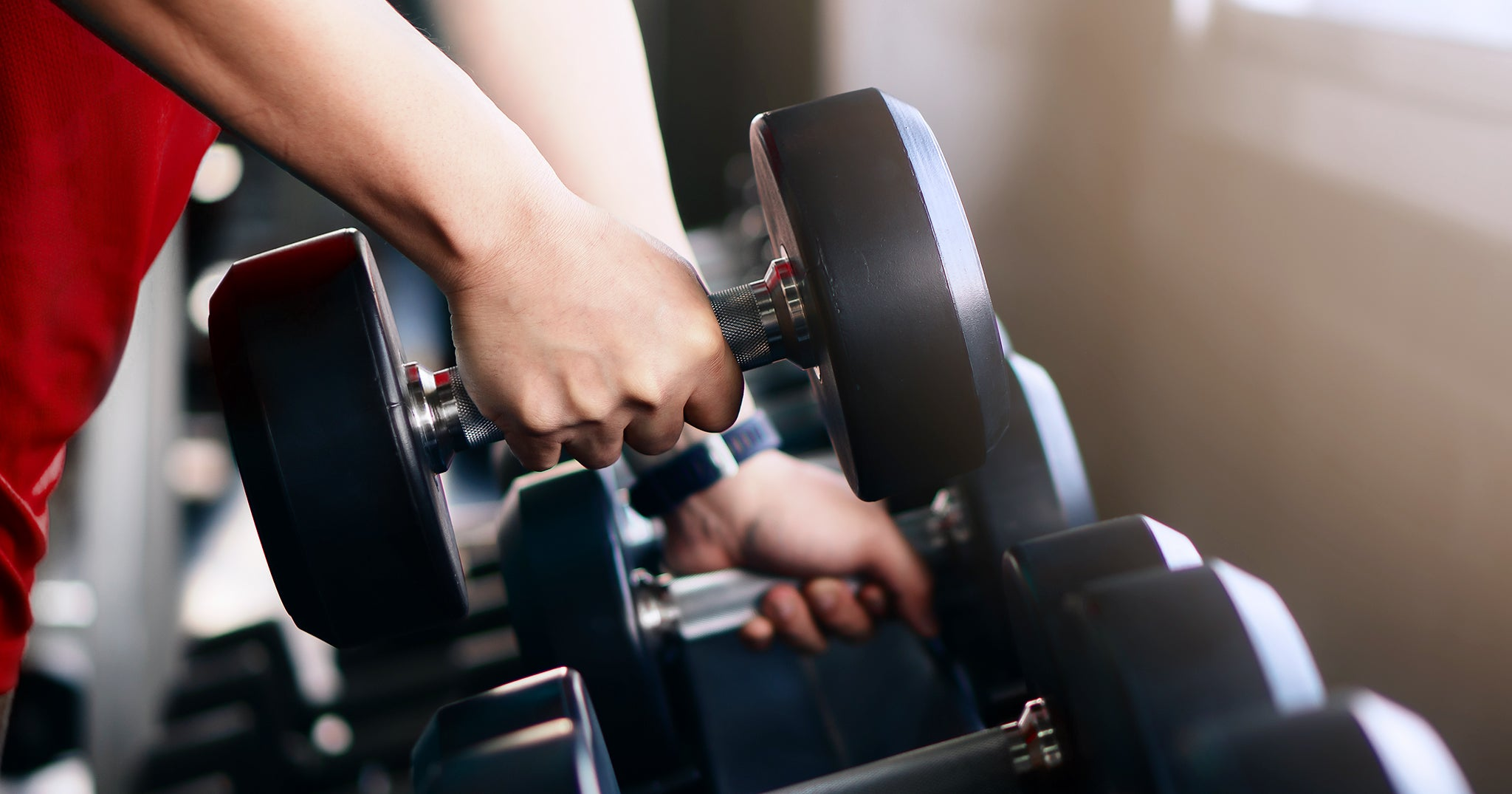 weight training, person lifting dumbbells