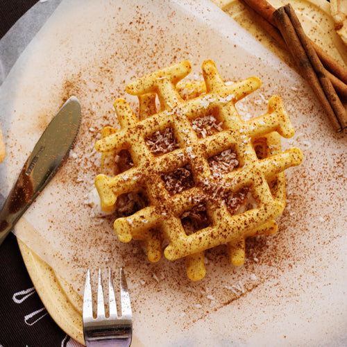 a piece of waffle on the plate