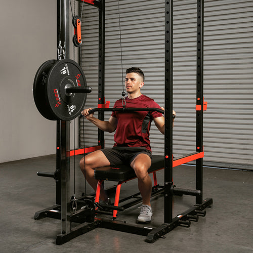 a man training with squat rack