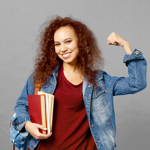 a female student holding books
