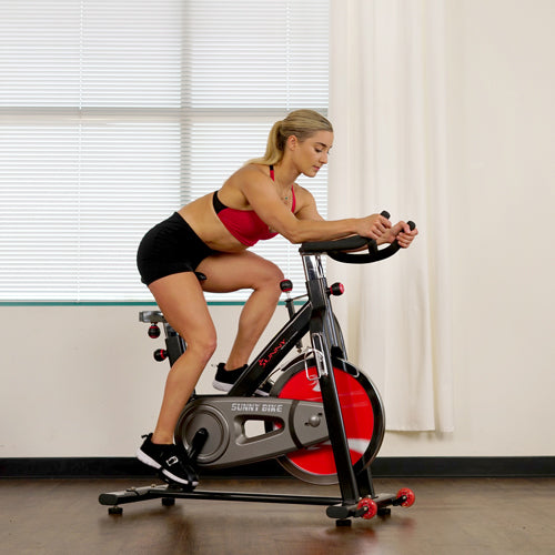 a female exerciser cycling