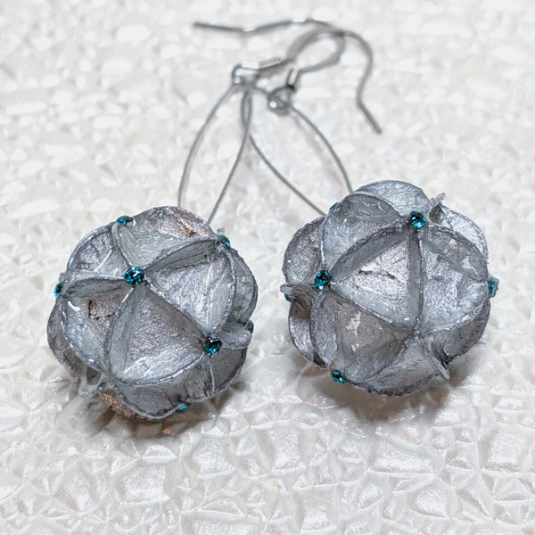 Earrings: Silver paper with blue rhinestones