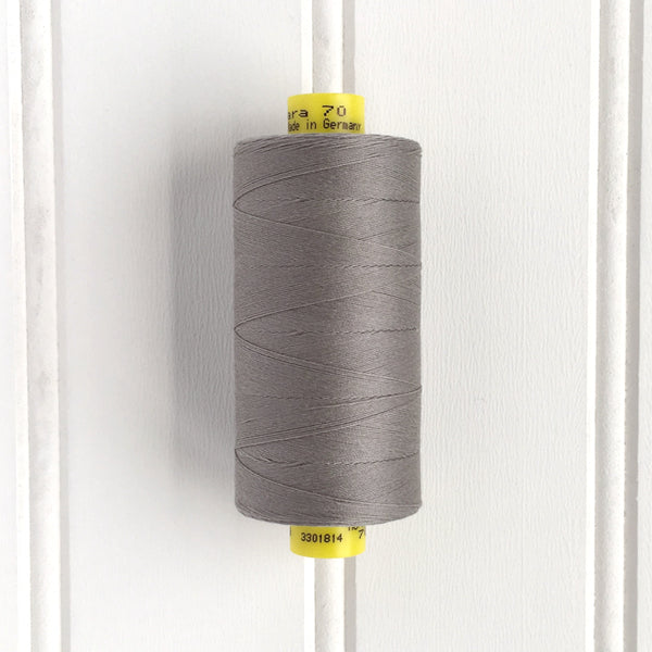 spool of gutermann mara 70 sewing thread in silver