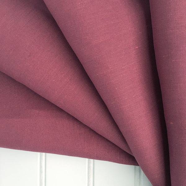 Fan folded mauve raspberry linen silk