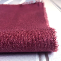 close-up of folded mauve raspberry raw silk noil