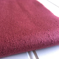 close-up of mauve raspberry raw silk noil texture