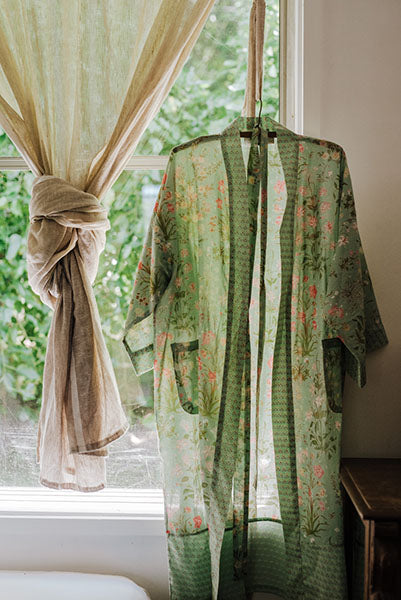 Colourful pure cotton voile kimono robe hanging in a window