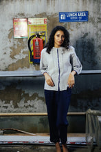 Load image into Gallery viewer, Dve Collection Ishi top in hand loomed khadi cotton ecru with indigo check, hand stitched faggoting and selvedge detailing, shell buttons, three quarter sleeves (side view).
