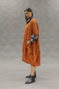 Kimberley Tonkin orange rust linen one size easy fit dress with contrast indigo stitching.
