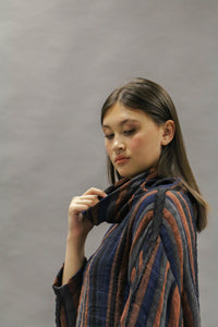 Kimberley Tonkin, Izzy cotton/linen striped pullover top with loose roll neck in charcoal, rust and indigo. Close up.