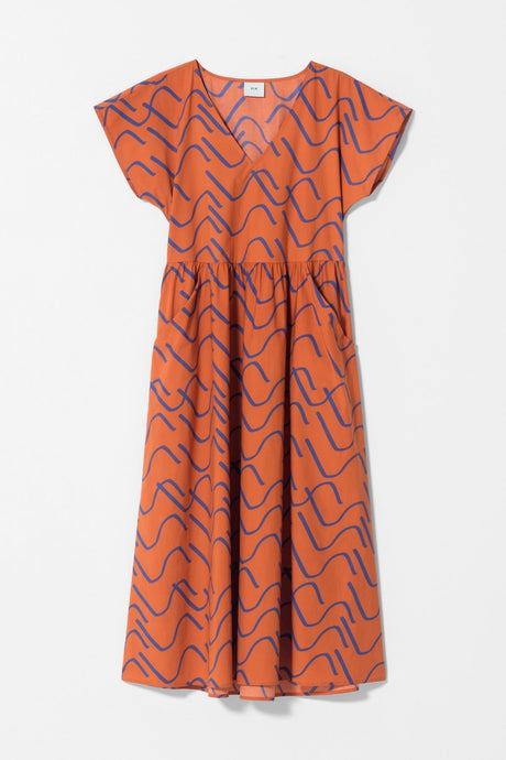 Elk Nomad summer 2020, Ollie dress made from organic cotton in original print, copper orange and cobalt blue.