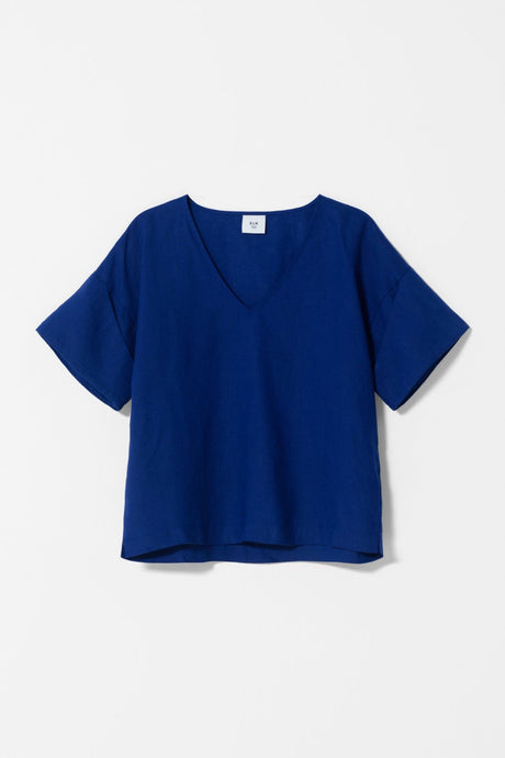 Elk Nomad Summer 2020 Hallvi top in cobalt blue French linen. Boxy shape, v neck cuffed sleeves to elbow.