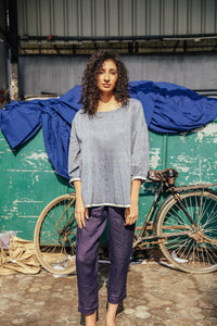 Dve Collection Anisha top in chambray khadi hand loomed cotton, pin tucked bodice front and back, three quarter sleeve, selvedge edge detail. One size.