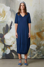 Load image into Gallery viewer, Valia Collective cotton knit calf length tulip shape dress with V-neck, short sleeves and pockets, in midnight blue.