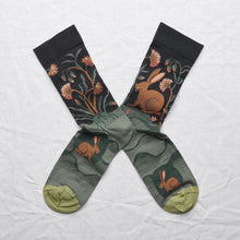 Load image into Gallery viewer, Bonne Maison fine cotton socks, made in France. Dark Hare rabbit hare on deep navy background with shades of green.