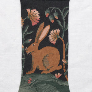 Bonne Maison fine cotton socks, made in France. Dark Hare rabbit hare on deep navy background with shades of green.