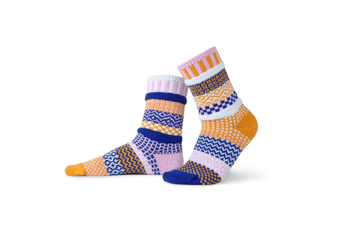 Solmate socks made from recycled cotton in the USA, Nova in pale pink, orange, white and bright blue.