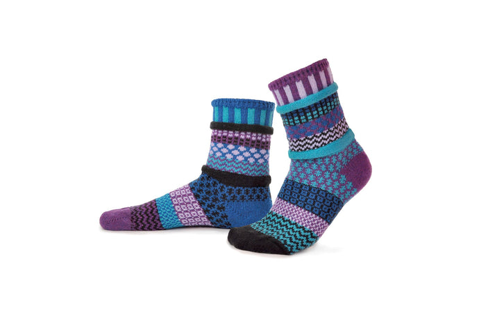 Solmate socks made in the USA from recycled cotton, Raspberry in berry tones ofturquoise, purple, black, lilac, royal blue.