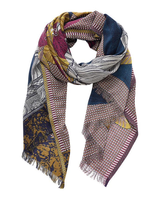 Inouitoosh Stanislas scarf in wool, cashmere and silk, depicting a cornucopia of fruit and leaves in an urn, shades of deep pomegranate, mustard and white with blue background.