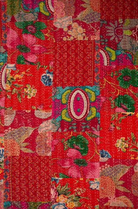 Red patchwork handstitched cotton kantha quilt.