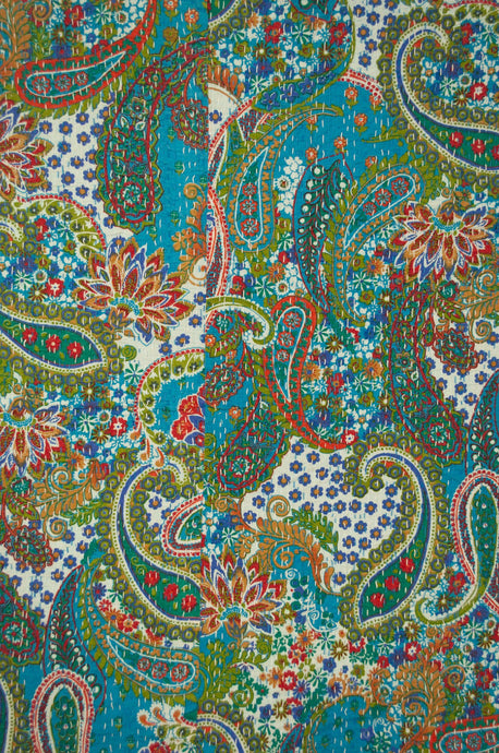 Handstitched cotton kantha quilt, a colourful paisley on a turuqoise background, with highlights in lime, emerald, red, white, and tan