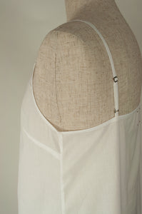 Ladies pure cotton voile full slip or petticoat, showing detail of adjustable straps in white.