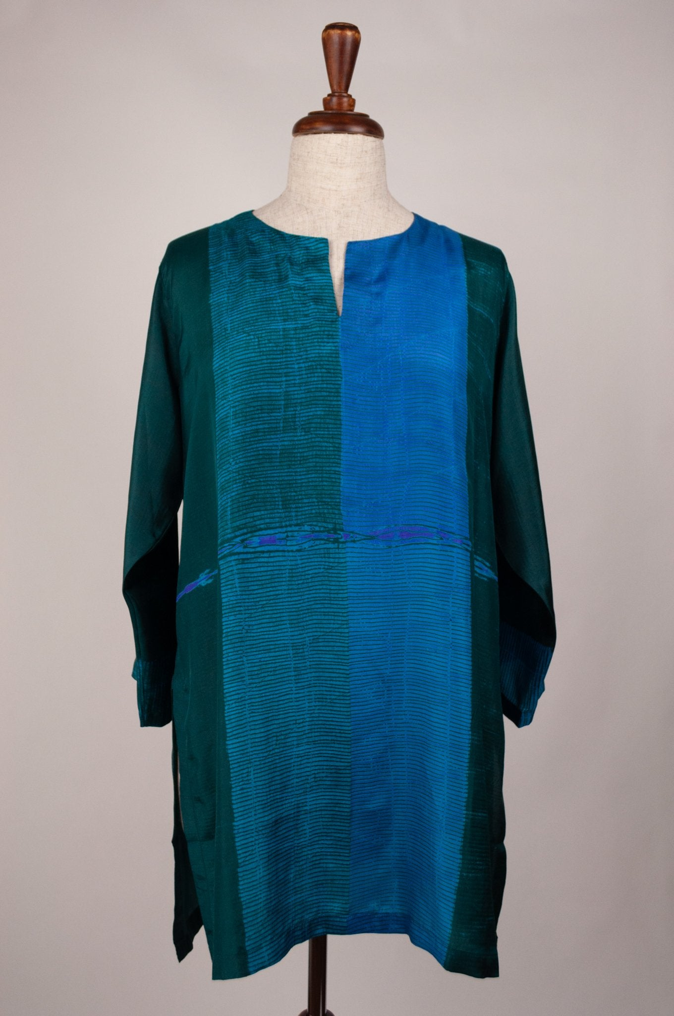 Pure silk shibori dyed silk kurta top in peacock tones of emerald and turquoise.