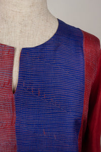 Pure silk shibori dyed silk kurta top in brick red and cobalt blue, neck detail.