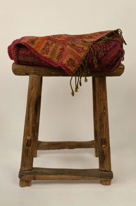 Juniper Hearth pure wool reversible tasseled throw rug with classic paisley design in reds, burgundy and gold.