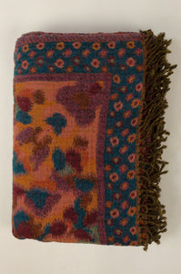 Juniper Hearth reversible pure wool tasseled throwcentral paisley design in saffron, pumpkin & burgundy with petrol blue & aqua accents, and a bold abstract spotted border