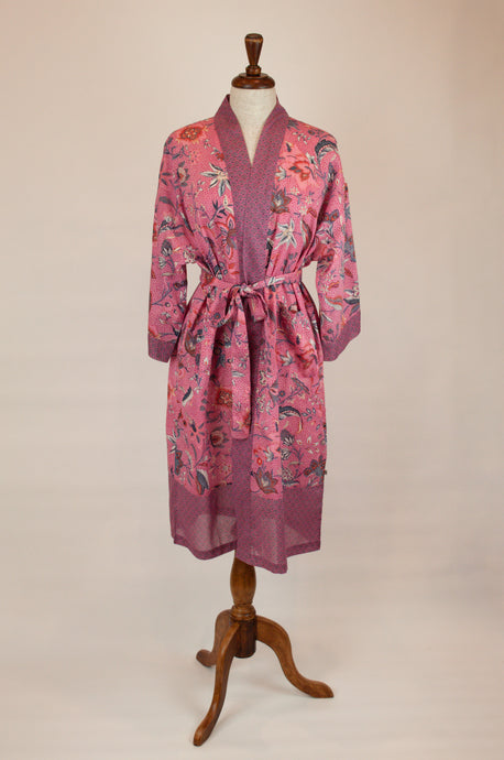 Cotton voile kimono robe dressing gown in a pink floral print and pink and blue geometric trim.
