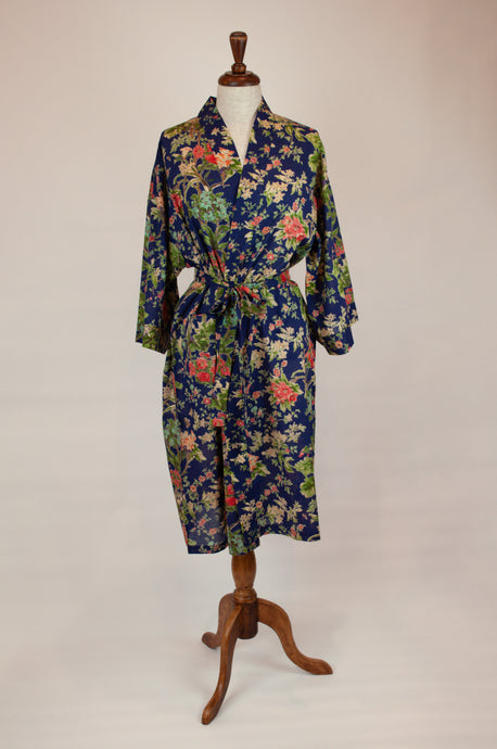 Cotton voile kimono robe dressing gown in navy with a pink, red and green floral print with matching trim.
