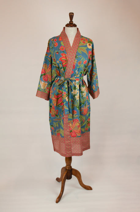 Cotton voile kimono robe dressing gown in mid blue with a tropical floral print in coral and cream and contrasting trim.
