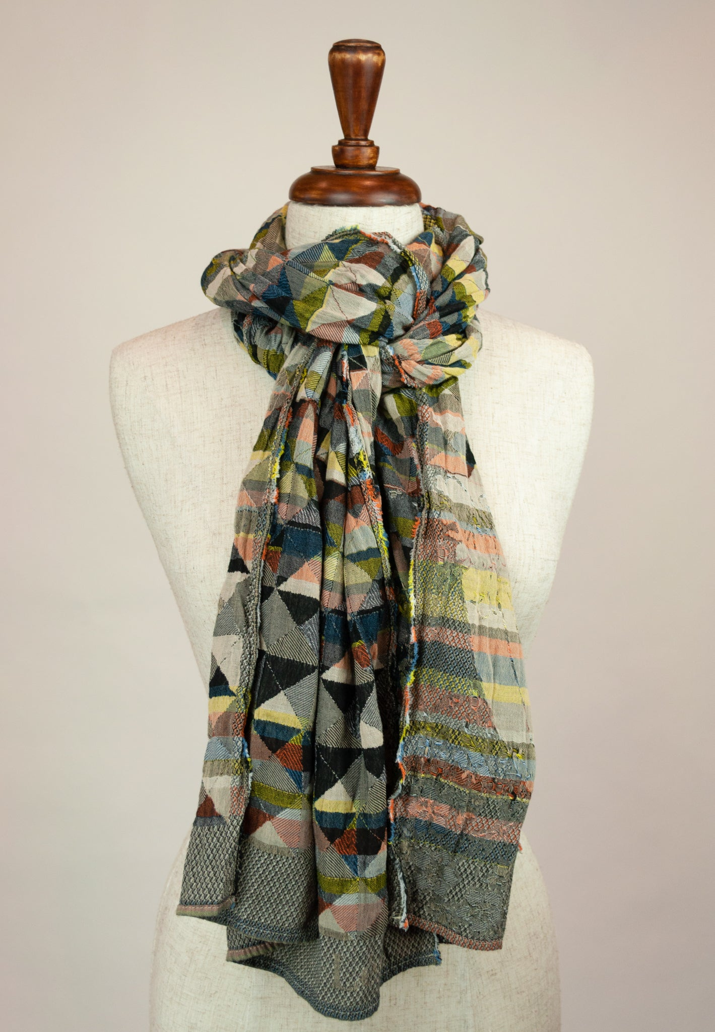 Létol French organic cotton scarf with a geometric Missoni inspired design in shades of red, green, gold, blue and black.