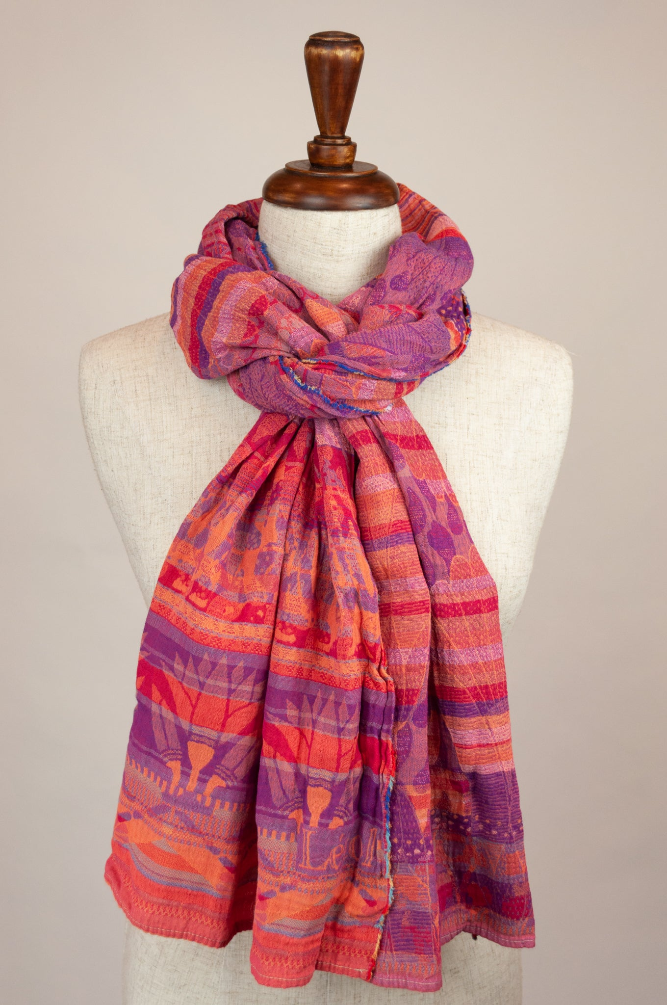 Létol French organic cotton scarf with a striped and floral design in tones of bright pink, cerise, purple and orange.